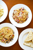 Various kind of Italian pasta spaghetti with tomato, proshutto, seafood
