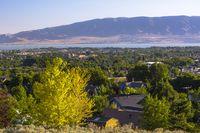 Utah Lake with houses and yellow tree