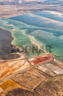 Dead Sea Israel landscape nature salt extraction portrait format from above aerial view Jordan