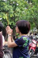 Woman pray and burn incense