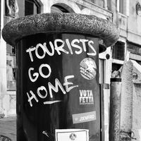 Tourists go home graffito in Venice