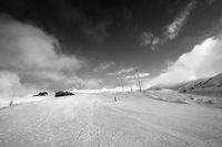 Snowboarder on piste slope in winter day