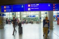 People  luggage Frankfurt airport Germany