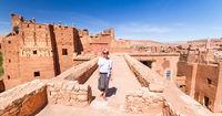 Woman on travel at Ait Benhaddou kasbah, Ouarzazate, Morocco.