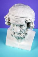 Gypsum copy of ancient statue Homer head on a blue green background. Plaster sculpture man face.