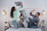 Family having pillow fight