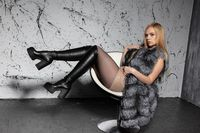 Young beautiful blonde posing sitting