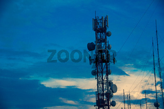 Telecommunication Tower with Wires and Anntenas with Dusk Sky Background,  Aerial Structure of Lines and Strands, Radio Frecuency Transmitters Network Complex