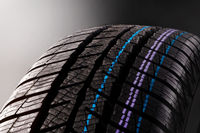 Snow tire isolated on dark background.