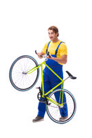 Man repairing his bike isolated on white background