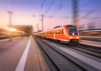 High speed red train with motion blur effect on the railway stat