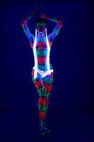 Slim girl with UV bodyart full-length shot