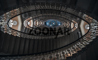 Spiral staircase with chandeliers