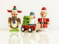 three Christmas figures reindeer Santa Claus toys