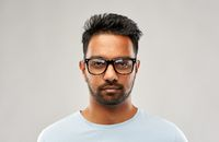 indian man or student in eyeglasses