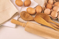 Top view of fresh eggs and utensils on table