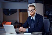 Businessman working behind a laptop