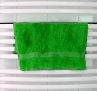 White metal heated towel rail set in the bathroom