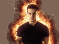 Young man with fire explosion or flame burst behind him