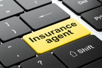 Insurance concept: Insurance Agent on computer keyboard background