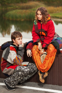 Young fashion hippie couple in love outdoor