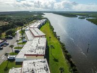 Business Buildings in a Row on the Riverfront Aerial Drone Shot Nature Outdoors Daytime Landscape