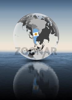 Argentina on translucent globe above water