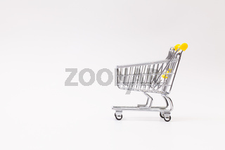 Shopping trolley on the white desk
