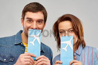 happy couple with air tickets