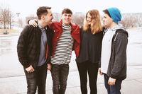 group of young urban friends having fun and laughing together