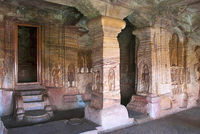Cave 4 : Interior view. The figure of Mahavira in the sanctu is partially seen, Jaina Tirthankara images engraved on the pillars and on the walls are also seen.