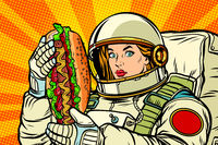 Hungry woman astronaut with hot dog