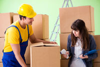 Woman boss and man contractor working with boxes delivery