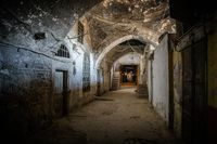 Dark brick abandoned tunnel, abstract exit to light concept background