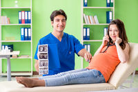 The pregnant woman visiting male gynecologyst at the clinic