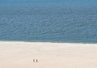 Single couple on wide beach at Cape May Point in New Jersey