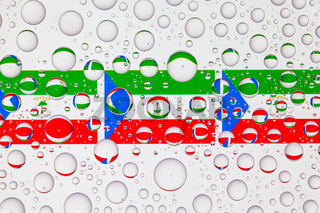 Water drops on glass and flags of Equatorial Guinea