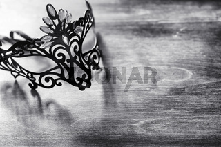 Carnival mask on the table. The subject of camouflage on a date