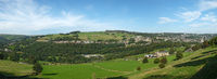 a long panoramic view of the calder valley showing the village of luddenden and the town of sowerby bridge with surrounding woodland and meadows