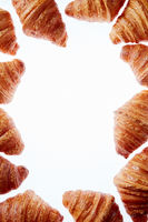 French croissants frame with copy space on a white background.