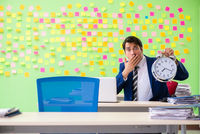 Businessman with many conflicting priorities in time management
