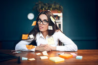 Business woman with sticky notes all over her.
