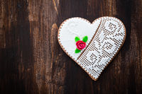 Homemade gingerbread heart on wooden background