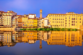 Arno river waterfront morning reflections in Florence