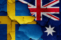 flags of Sweden and Australia painted on cracked wall