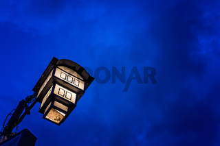 Street lamp lit at night