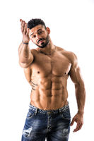 Muscular man pointing at you