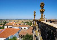 Decorative stone torches on the balcony of Evora Cathedral (Se). Evora. Portugal