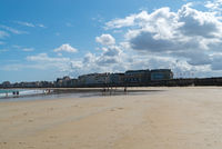 tourists enjoy a beautiful day on the beaches at Saint-Malo in Normandy during the long summer holdiays
