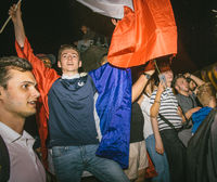Fans celebrating qualification victory of France for final FIFA